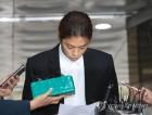 포승줄 묶여 포토라인 노출된 정준영…피의자 인권 논란 재연